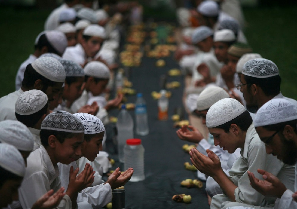 Muslims offer prayers before having their Iftar (fast-breaking) meal during the holy month of Ramadan- picture from Christian Post