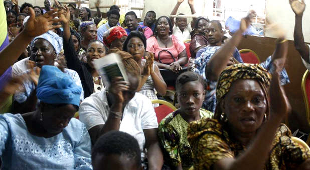 Congregants of Flaming Evangelical Ministries in Sierra Leone worship
