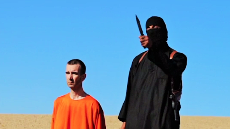 British aid worker David Haines seen with an ISIS militant in a video